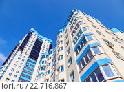 Купить «New tall modern apartment buildings against blue sky background», фото № 22716867, снято 1 июля 2018 г. (c) FotograFF / Фотобанк Лори