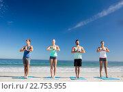 Купить «People doing yoga on the beach», фото № 22753955, снято 10 марта 2016 г. (c) Wavebreak Media / Фотобанк Лори