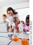 Купить «Cute pupil looking through microscope with teacher», фото № 22754527, снято 6 марта 2016 г. (c) Wavebreak Media / Фотобанк Лори