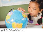Купить «Girl studying the globe», фото № 22754615, снято 5 марта 2016 г. (c) Wavebreak Media / Фотобанк Лори