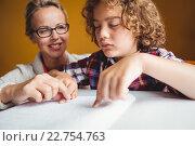 Купить «Boy using braille to read», фото № 22754763, снято 5 марта 2016 г. (c) Wavebreak Media / Фотобанк Лори