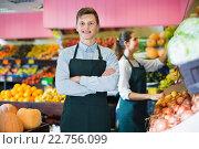 Купить «Young sellers having vegetables and fruits on displays of market», фото № 22756099, снято 26 июня 2019 г. (c) Яков Филимонов / Фотобанк Лори