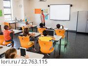 Купить «Teacher giving lesson to her students», фото № 22763115, снято 6 марта 2016 г. (c) Wavebreak Media / Фотобанк Лори
