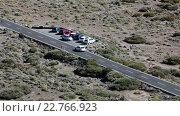 Купить «Car driving slowly and finding place for parking near Teleferico cable car. The TF-21 is a road through the Teide mountain in Teno massif, Tenerife, Canary, Spain», видеоролик № 22766923, снято 18 февраля 2016 г. (c) Кекяляйнен Андрей / Фотобанк Лори
