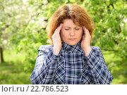 Купить «woman with a headache on nature of the spring», фото № 22786523, снято 7 мая 2016 г. (c) Володина Ольга / Фотобанк Лори