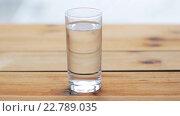 Купить «water pouring into glass on wooden table», видеоролик № 22789035, снято 2 апреля 2016 г. (c) Syda Productions / Фотобанк Лори