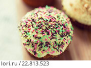Купить «close up of glazed cupcake or muffin on table», фото № 22813523, снято 21 мая 2015 г. (c) Syda Productions / Фотобанк Лори