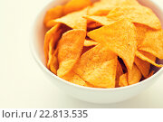 Купить «close up of corn crisps or nachos in bowl», фото № 22813535, снято 21 мая 2015 г. (c) Syda Productions / Фотобанк Лори