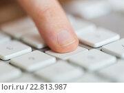 Купить «close up of finger pressing button on keyboard», фото № 22813987, снято 22 марта 2016 г. (c) Syda Productions / Фотобанк Лори