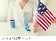 Купить «close up of woman holding american flag», фото № 22814007, снято 28 мая 2015 г. (c) Syda Productions / Фотобанк Лори