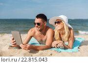 Купить «happy couple with tablet pc sunbathing on beach», фото № 22815043, снято 11 августа 2015 г. (c) Syda Productions / Фотобанк Лори