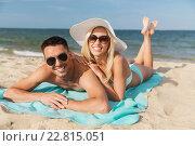 Купить «happy couple in swimwear lying on summer beach», фото № 22815051, снято 11 августа 2015 г. (c) Syda Productions / Фотобанк Лори