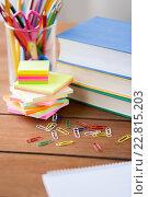 Купить «close up of pens, books, clips and stickers», фото № 22815203, снято 17 марта 2016 г. (c) Syda Productions / Фотобанк Лори