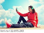 Купить «happy young woman with smartphone and headphones», фото № 22815243, снято 19 марта 2015 г. (c) Syda Productions / Фотобанк Лори