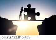 Купить «silhouette of woman moving puzzle over sun light», фото № 22815435, снято 22 сентября 2019 г. (c) Syda Productions / Фотобанк Лори