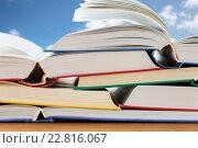 Купить «close up of books on wooden table», фото № 22816067, снято 17 марта 2016 г. (c) Syda Productions / Фотобанк Лори