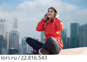 Купить «happy young woman in headphones listening to music», фото № 22816543, снято 19 марта 2015 г. (c) Syda Productions / Фотобанк Лори