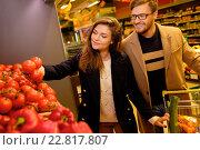 Купить «Couple choosing vegetables in a grocery store», фото № 22817807, снято 9 октября 2015 г. (c) Andrejs Pidjass / Фотобанк Лори