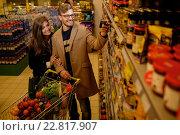 Купить «Young couple in a grocery store», фото № 22817907, снято 9 октября 2015 г. (c) Andrejs Pidjass / Фотобанк Лори