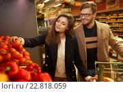 Купить «Couple choosing vegetables in a grocery store», фото № 22818059, снято 9 октября 2015 г. (c) Andrejs Pidjass / Фотобанк Лори