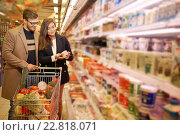 Купить «Young couple in a grocery store», фото № 22818071, снято 9 октября 2015 г. (c) Andrejs Pidjass / Фотобанк Лори