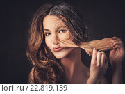 Купить «Aging and skin care concept. Half old half young woman, takes off the old skin from the face.», фото № 22819139, снято 12 февраля 2016 г. (c) Andrejs Pidjass / Фотобанк Лори