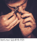 Купить «Portrait of a jeweler during the evaluation of jewels.», фото № 22819151, снято 26 декабря 2015 г. (c) Andrejs Pidjass / Фотобанк Лори