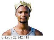Купить «Portrait of victorious sportsman with crown of laurels», фото № 22842415, снято 20 сентября 2019 г. (c) Wavebreak Media / Фотобанк Лори