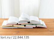 Купить «close up of books on wooden table», фото № 22844135, снято 17 марта 2016 г. (c) Syda Productions / Фотобанк Лори