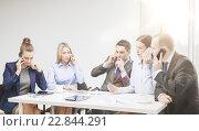 Купить «business team with smartphones having conversation», фото № 22844291, снято 9 ноября 2013 г. (c) Syda Productions / Фотобанк Лори