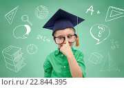 Купить «boy in bachelor hat and eyeglasses over blackboard», фото № 22844395, снято 31 января 2016 г. (c) Syda Productions / Фотобанк Лори