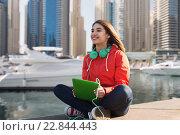 Купить «happy young woman with tablet pc and headphones», фото № 22844443, снято 19 марта 2015 г. (c) Syda Productions / Фотобанк Лори