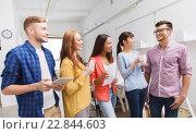 Купить «creative team on coffee break talking at office», фото № 22844603, снято 27 февраля 2016 г. (c) Syda Productions / Фотобанк Лори