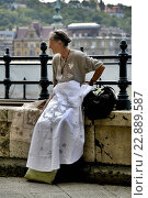 Купить «Hungary, Budapest (Pest), A Lacemaker selling her work on Lower Pesti Quay», фото № 22889587, снято 26 марта 2019 г. (c) age Fotostock / Фотобанк Лори