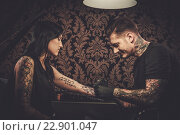 Купить «Professional tattoo artist makes a tattoo on a young girl's hand.», фото № 22901047, снято 8 мая 2016 г. (c) Andrejs Pidjass / Фотобанк Лори