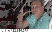 Купить «Tired after training man showing thumb-up», видеоролик № 22916579, снято 18 марта 2016 г. (c) Данил Руденко / Фотобанк Лори