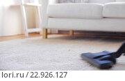 Купить «woman with vacuum cleaner cleaning carpet at home», видеоролик № 22926127, снято 17 апреля 2016 г. (c) Syda Productions / Фотобанк Лори