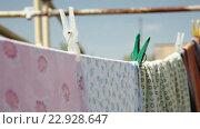 Купить «Clothes drying in the fresh одежда сушится на свежем воздухе», видеоролик № 22928647, снято 19 мая 2016 г. (c) Константин Колосов / Фотобанк Лори