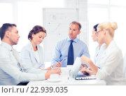 Купить «business team having meeting in office», фото № 22939035, снято 9 июня 2013 г. (c) Syda Productions / Фотобанк Лори