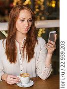 Купить «woman with smartphone and coffee at restaurant», фото № 22939203, снято 8 ноября 2015 г. (c) Syda Productions / Фотобанк Лори