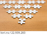 close up of puzzle pieces on wooden surface. Стоковое фото, фотограф Syda Productions / Фотобанк Лори