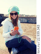Купить «happy young woman with smartphone and headphones», фото № 22939343, снято 19 марта 2015 г. (c) Syda Productions / Фотобанк Лори
