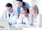 Купить «group of doctors looking at tablet pc», фото № 22939475, снято 18 мая 2013 г. (c) Syda Productions / Фотобанк Лори