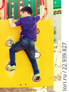 Купить «happy little boy climbing on children playground», фото № 22939827, снято 13 июня 2015 г. (c) Syda Productions / Фотобанк Лори