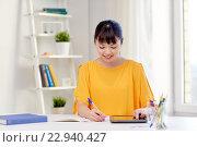 Купить «asian woman student with tablet pc at home», фото № 22940427, снято 9 марта 2016 г. (c) Syda Productions / Фотобанк Лори