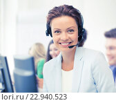 Купить «helpline operator with headphones in call centre», фото № 22940523, снято 9 июня 2013 г. (c) Syda Productions / Фотобанк Лори