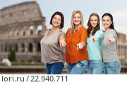 Купить «group of happy women pointing finger over coliseum», фото № 22940711, снято 17 апреля 2016 г. (c) Syda Productions / Фотобанк Лори