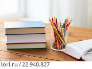 Купить «close up of crayons or color pencils and books», фото № 22940827, снято 17 марта 2016 г. (c) Syda Productions / Фотобанк Лори