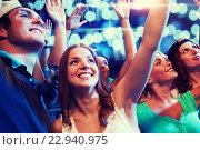 Купить «smiling friends at concert in club», фото № 22940975, снято 20 октября 2014 г. (c) Syda Productions / Фотобанк Лори
