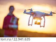 Купить «drone flying at sunset», фото № 22941635, снято 6 мая 2016 г. (c) Дмитрий Калиновский / Фотобанк Лори